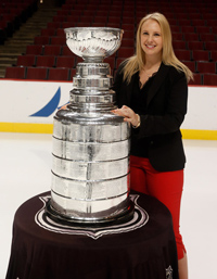 Leah poses with the Stanley Cup in 2013.